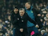 Everton manager Carlo Ancelotti celebrates their first goal scorted by Everton's Dominic Calvert-Lewin with coach Duncan Ferguson and assistant manager Davide Ancelotti on December 26, 2019