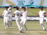 England's James Anderson celebrates taking the wicket of South Africa's Dean Elgar, caught by England's Jos Buttler with Ben Stokes and teammates on December 26, 2019
