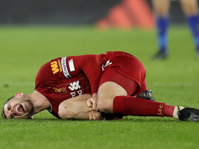 Liverpool captain Jordan Henderson lies injured on December 26, 2019