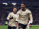 Manchester United's Marcus Rashford celebrates scoring their second goal with Jesse Lingard on December 28, 2019