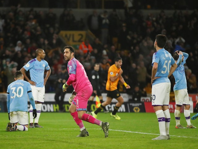 Manchester City's Claudio Bravo reacts after Wolverhampton Wanderers' Raul Jimenez scores their second goal on December 27, 2019