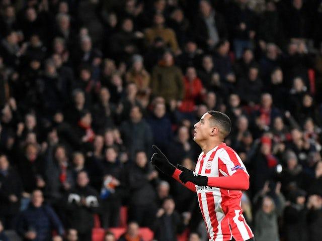 PSV Eindhoven midfielder Mohamed Ihattaren celebrates in December 2019