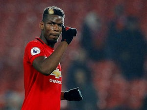 Pogba returns to Man Utd training ground