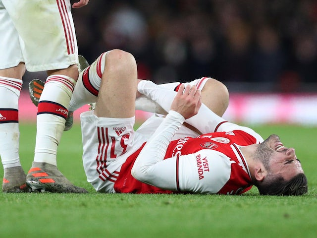 Arsenal's Sead Kolasinac reacts after sustaining an injury from a challenge from Manchester City's Rodri