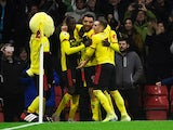 Watford's Troy Deeney celebrates scoring their second goal with teammates on December 28, 2019
