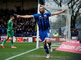 Rochdale's Aaron Wilbraham celebrates scoring their first goal on January 4, 2020