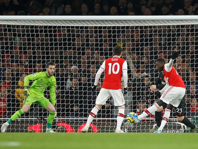 Arsenal's Nicolas Pepe scores against Manchester United in the Premier League on January 1, 2020