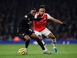 Arsenal's Pierre-Emerick Aubameyang in action with Manchester United's Aaron Wan-Bissaka in the Premier League on January 1, 2020