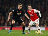 Arsenal's Mesut Ozil in action with Manchester United's Nemanja Matic in the Premier League on January 1, 2020