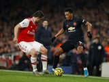 Arsenal's Sokratis in action with Manchester United's Anthony Martial in the Premier League on January 1, 2020