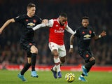 Arsenal's Alexandre Lacazette in action with Manchester United's Nemanja Matic in the Premier League on January 1, 2020