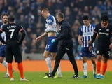 Brighton & Hove Albion's Dan Burn walks off after sustaining an injury on January 1, 2020