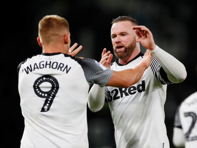 Derby Country's Martyn Waghorn celebrates scoring their second goal with Wayne Rooney on January 2, 2020