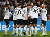 Derby County's Chris Martin celebrates scoring their first goal with Wayne Rooney and teammates on January 5, 2020