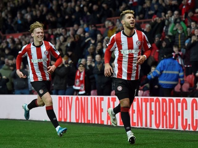 Brentford's Emiliano Marcondes celebrates scoring their first goal on January 4, 2020