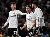 Fulham's Harry Arter celebrates scoring their second goal with Joe Bryan and Cyrus Christie on January 4, 2020