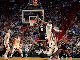 Miami Heat center Bam Adebayo (13) fouls Toronto Raptors guard Terence Davis (0) during the second half at American Airlines Arena on January 3, 2020