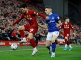 Liverpool's Takumi Minamino in action with Everton's Lucas Digne in the FA Cup on January 5, 2020