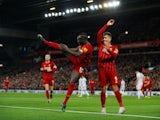 Liverpool's Sadio Mane celebrates scoring their second goal with Roberto Firmino on January 2, 2020