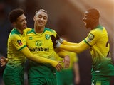 Norwich City's Adam Idah celebrates scoring their third goal with Ibrahim Amadou and Jamal Lewis on January 4, 2020