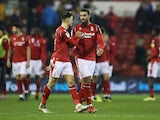 Nottingham Forest's Matty Cash and Lewis Grabban celebrate after the match on January 1, 2020