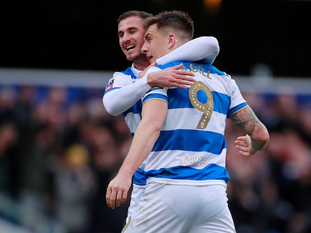 Queens Park Rangers' Jordan Hugill celebrates scoring their first goal with Dominic Ball on January 5, 2020
