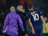 Tottenham Hotspur manager Jose Mourinho with Harry Kane as he goes off injured on January 1, 2020