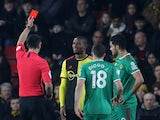 Watford's Christian Kabasele is shown a red card by referee Andy Madley after a VAR review on January 1, 2020
