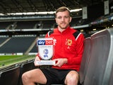 Alex Gilbey poses with his League One Player of the Month award for December 2019