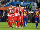 Atletico Madrid's Kieran Trippier celebrates with Thomas Partey and teammates after the match on January 9, 2020