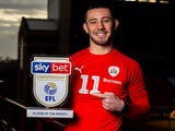 Conor Chaplin poses with his Championship Player of the Month award for December 2019