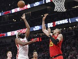 Houston Rockets guard James Harden (13) shoots over Atlanta Hawks center Alex Len (25) during the first half at State Farm Arena on January 9, 2020