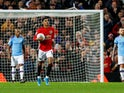Marcus Rashford celebrates pulling one back during the EFL Cup game between Manchester United and Manchester City on January 7, 2020