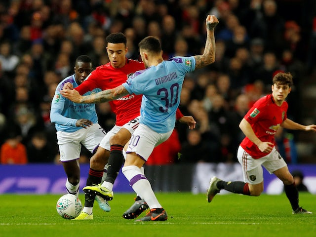 Mason Greenwood and Nicolas Otamendi in action during the EFL Cup game between Manchester United and Manchester City on January 7, 2020