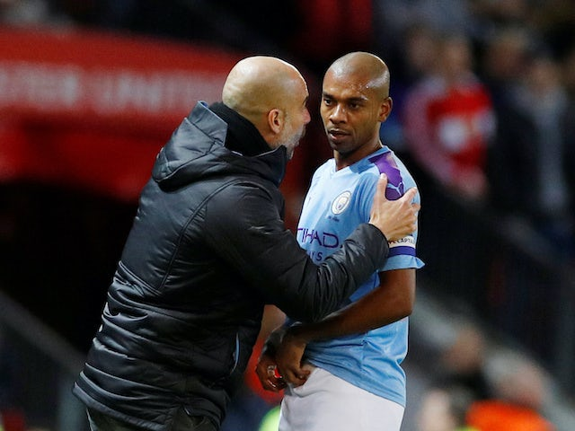 Pep Guardiola gives instructions to Fernandinho during the EFL Cup game between Manchester United and Manchester City on January 7, 2020