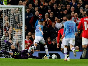 Man City outclass Man Utd to put one foot in EFL Cup final