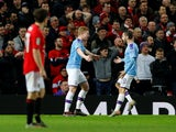 Kevin De Bruyne celebrates Andreas Pereira's own goal with Bernardo Silva during the EFL Cup game between Manchester United and Manchester City on January 7, 2020
