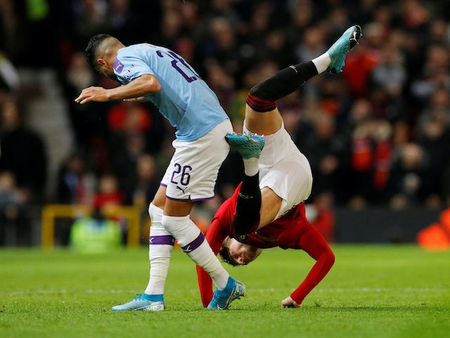 Riyad Mahrez in action with Brandon Williams during the EFL Cup game between Manchester United and Manchester City on January 7, 2020