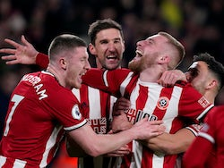 Sheffield United's Oliver McBurnie celebrates scoring their first goal with Chris Basham, John Lundstram and George Baldock on January 10, 2020