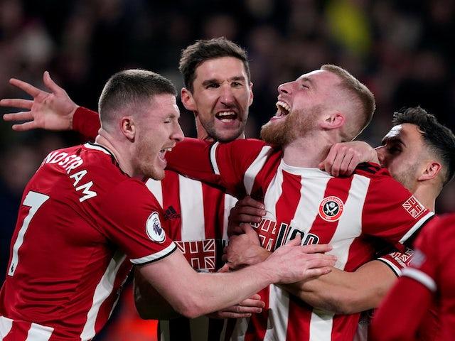 Sheffield United's Oliver McBurnie celebrates scoring their first goal with Chris Basham, John Lundstram and George Baldock on January 10, 2020