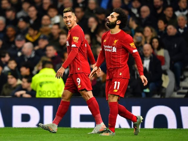 Roberto Firmino celebrates opening the scoring during the Premier League game between Tottenham Hotspur and Liverpool on January 11, 2020