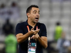 Barcelona-linked Xavi signs new two-year contract