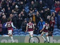 Burnley's Ashley Westwood celebrates scoring their second goal with Phil Bardsley and Jeff Hendrick on January 19, 2020