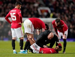 Manchester United's Marcus Rashford receives medical attention after sustaining an injury on January 15, 2020