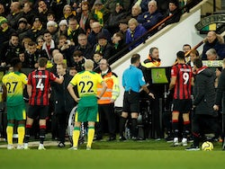 The referee views the VAR monitor which results in Norwich City's Ben Godfrey being shown a red card on January 18, 2020