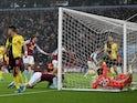 Aston Villa's Douglas Luiz celebrates scoring their first goal with teammates as Watford's Ben Foster falls into the net on January 21, 2020