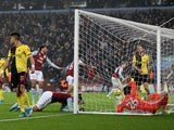 Aston Villa's Douglas Luiz celebrates scoring their first goal with teammates as Watford's Ben Foster falls into the net on January 21, 2020
