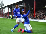 Leicester City's Kelechi Iheanacho celebrates scoring their first goal with teammate Demarai Gray on January 25, 2020