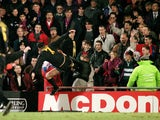 Manchester United's Eric Cantona kung fu kicks Crystal Palace fan Matthew Simmons following abuse after being sent off