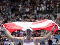 Denmark's Caroline Wozniacki holds the flag of Denmark as she heads into retirement after losing the match against Tunisia's Ons Jabeur on January 24, 2020.